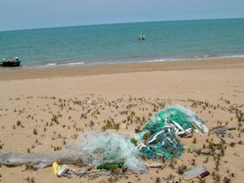 Ghost nets and trash from illegal fishing boats litter every metre of the beach